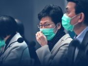 Hong Kong hospitals on the verge of collapse as outbreak escalates